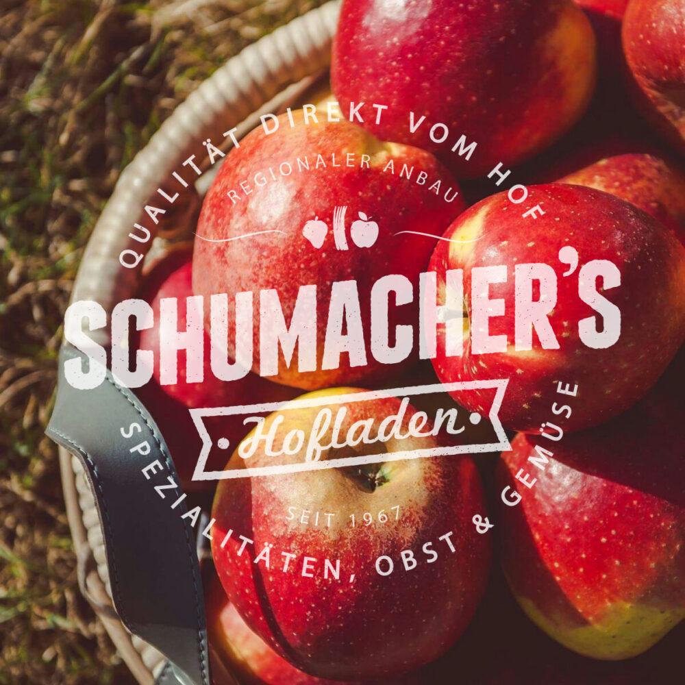 Korb mit Äpfeln mit Logo Schumacher's Hofladen